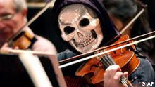 Craig Kirkland of the Eastern Connecticut Symphony Orchestra in New London, Conn., plays his viola during a Young People's Concert for area school children featuring creepy classical music and the ECSO members in Halloween costume at the Garde Arts Center in New London, Thursday, Oct. 30, 2003. (AP Photo/The Day, Tim Cook) ** MAGS OUT, TV OUT, NO SALES **