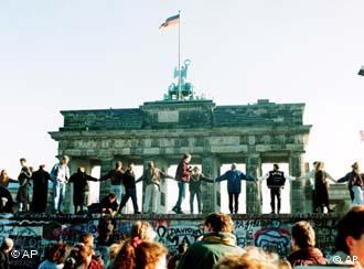 Berliners sing and dance atop the wall to celebrate the opening of East-West German borders November 10, 1989