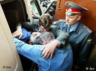 Russian police arresting mafia suspect