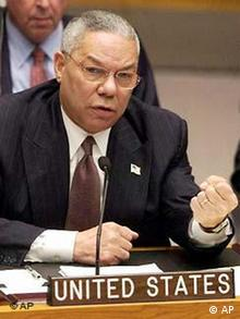 U.S. Secretary of State Colin Powell clenches his fist as he addresses a meeting of the United Nations Security Council