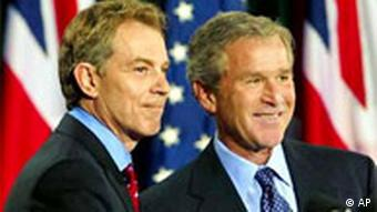 US President George W. Bush and British Prime Minister Tony Blair finish a press conference following their overnight war summit at Camp David in 2003