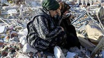 Women crying in the rubble of an earthquake