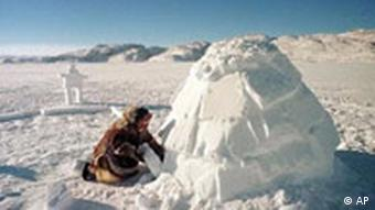 An Inuit covers the opening of an iglu