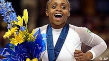 Brazil's Daiane Dos Santos reacts after receiving her gold medal in the floor exercise during the Individual Event Finals at the 2003 World Gymnastics Championships in Anaheim, Calif., Sunday, Aug. 24, 2003. (AP Photo/Mark J. Terrill)