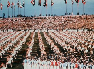 This 1938 photo is of a major Nazi public celebration in Nuremberg, the Reichsparteitag, or national celebration day. Thousands are marching in unison.