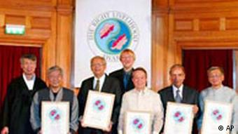 Swedish Jakob von Uexkull (fourth from left) poses together with Right Livelihood award recipients, after handing over prizes to them at the Swedish parliament in Stockholm, Sweden Monday Dec. 8 2003. Others from left: Chul-young Shin and Kyung-suk Soh of the Citizens Coalition for Economic Justice from South Korea; honorary prize winner former New Zealand Prime Minister David Lange; Nicanor Perlas of the Philippines; Ibrahim Abouleish of Egyptian SEKEM, a network of businesses and social civil groups; Walden Bello of the Philippines. (AP Photo/Ola Torkelsson) ** SWEDEN OUT **