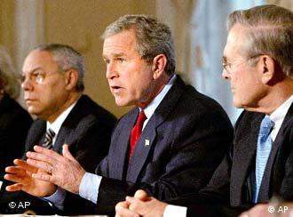 Bush with advisers Colin Powell and Donald Rumsfeld, around the time of the Iraq invasion