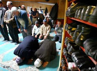 Turkish Muslims at prayer in a mosque in Berlin