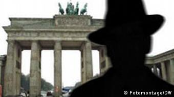 The silhoette of a spy figure in front of the Brandeburg Gate in Berlin