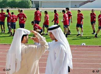 Two Emirates soccer fans talks to each other as Bayern Munich practise