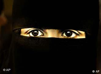 Woman wearing a black headscarf, only her eyes are visible.