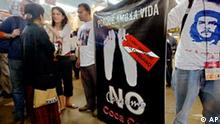 Columbian delegation members protest against Coca-Cola, at the World Social Forum in Bombay, India, Sunday Jan. 18, 2004. After protests against unfair global trade, big business and foreign debt, the third day of the annual anti-globalization and anti-war protest was packed with seminars and conferences seeking to link peace movements across the world to fight militarism. The banner, written in Spanish reads Because I want to live say no to Coca-Cola. The photograph of Che Guevara is seen on the t-shirt of the right side delegate. (AP Photo/Manish Swarup)