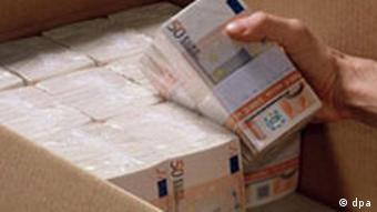 500 euro bills being bundled and packed into a carton