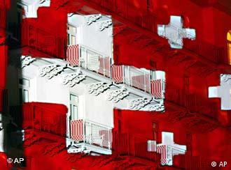 The hotel Belvedere in Davos is lit with Swiss crosses