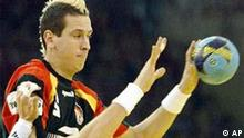 German handball player Pascal Hens, left, and Danish handball player Lars Joergensen, right, challenge for the ball during the first semifinal match between Germany and Denmark at the Men's European Championship in Ljubljana, Slovenia, on Saturday, Jan. 31, 2004. Germany won the match with 22-20. (AP Photo/Christof Stache)