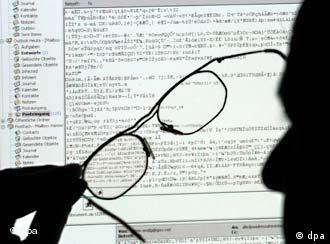 A man scans a computer screen for mails carrying viruses