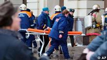 Emergency Situations Ministry rescuers rush to the Paveletskaya metro station Friday, Feb. 6, 2004. An explosion hit the Moscow metro during Friday morning rush hour, killing at least 30 people, wounding dozens of others and sending clouds of smoke through the tunnel. (AP Photo/ Misha Japaridze)