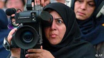Iranian camerawoman Nasrin Ashitiani and sound engineer Shain Mesri cover the opening ceremony of the Non-Governmental Organizations Forum on Women for the Islamic Republic of Iran Broadcasting, at the Olympic Stadium in Beijing Wednesday August 30, 1995. (AP Photo/Anat Givon)