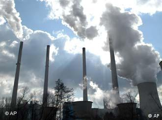 A energy plant with smoke coming out of its chimneys