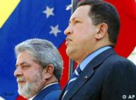 Brazil's President Luiz Inacio Lula da Silva, left, stands with his Venezuelan counterpart Hugo Chavez at Miraflores palace in Caracas,Venezuela, Friday, Feb. 27,2004. Silva is in Venezuela for the Group 15 Summit to be held today and Saturday. In the background is Venezuela's national flag. (AP Photo/Ricardo Stuckert, Agencia Brasil) **BRAZIL OUT**