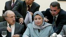 Iraqi Governing Council members Dr. Rajaa Al-Khuzaai, right seated, and Mahmoud Othman, seated at left, discuss with unidentified Iraqi officials during the resumption of their meeting to rush through Iraq's interim constitution Sunday Feb. 29, 2004 in Baghdad, Iraq. The Council members struggled on Sunday to find compromises on the shape of Kurdish autonomy and the role of Islamic law in an interim constitution, but officials said a final document won't be announced for several days. (AP Photo/POOL)