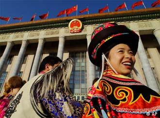 Chinese ethnic minority delegates arrive to attend the opening session of the 10th National People's Congress (NPC) at the Great Hall of the People in Beijing, China, Friday, March 5, 2004. China's government is promising heavy new spending in 2004 to improve the lives of millions of farm families, financed by robust but slower economic growth of 7 percent and aggressive new capitalist-style reforms. (AP Photo/Eugene Hoshiko)