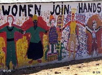 A mural on a wall calls for solidarity among women