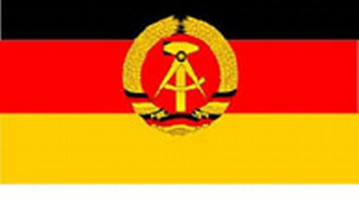 East German flag with black-red-gold with hammer and compass.
