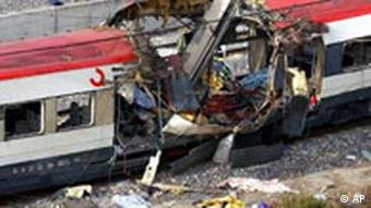 Debris lies next to a destroyed train car after a bomb