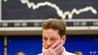 A stock trader reacts at the Frankfurt stock market