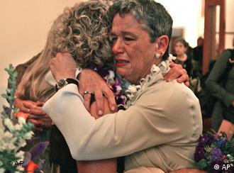 A couple cries after hearing on Friday that California's highest court won't allow them to marry.