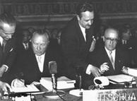 German Chancellor Konrad Adenauer (left) places his signature on the treaties