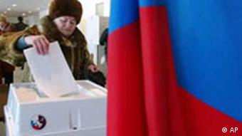 A woman votes in the 2004 elections
