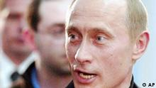 Russian President Vladimir Putin speaks during a news conference in Moscow early Monday, March 15, 2004. Putin captured 71.2 percent of Sunday's vote to win a second, four-year term, Central Election Commission chief Alexander Veshnyakov said early Monday. (AP Photo/Ivan Sekretarev)