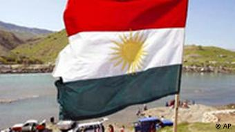 The Iraqi Kurdistan flag planted in the ground at the Dukan river near Sulaymaniyah