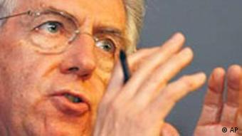 European Union Commissioner for Competition Mario Monti gestures while speaking during a media conference at European Commission headquarters in Brussels, Wednesday March 24, 2004. The European Union found Microsoft Corp. guilty Wednesday of abusing its near monopoly with Windows to squeeze competitors in other markets and levied a record fine of 497.2 million ($613 million). (AP Photo/Virginia Mayo)