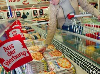 A woman shopping for pizza