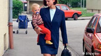 Jungunternehmerin mit Kind (Anja)