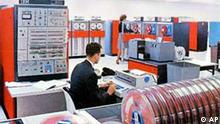 ** FILE ** This is a 1964 IBM promotional handout photo of the IBM 360 computer taken at an unknown location. The IBM's System 360 was a big deal when it was unveiled 40 years ago on April 7, 1964. Technology historians say that the 360 was one of the most influential computer rollouts ever. A special IBM selectric typewriter, being used by the man, would allow programmers to talk to the mainframe, left background. (AP Photo/IBM) ** zu unserem KORR. **