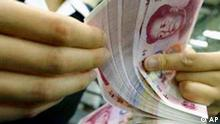 A Bank of China employee counting Chinese 100 Yuan notes at a branch outlet in Beijing, China, Thursday, July 3, 2003. For nearly a decade, Beijing has tied its currency to the U.S. dollar and kept it from being traded in global markets _ a strategy that brought China stability and helped to shield it from the 1997 Asian financial crisis. But as its exports surge, China is facing growing demands to raise the yuan's value. Washington and other governments complain the currency is too cheap and gives Chinese exports an unfair advantages, hurting foreign companies and wiping out job. (AP Photo/Ng Han Guan)