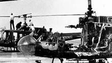 Two West German border police helicopters that carried armed terrorists and their nine Israeli Olympian hostages, stand at Fuerstenfeldbruck air force base, twenty miles west of Munich, Germany, on Sept. 7, 1972. The helicopter in foreground is a burned out shell as a result of a hand grenade explosion set off by one of the Palestinian kidnappers of the Israeli Olympic team apparently committing suicide rather than risking capture in the evening of Sept. 5th. A 20-hour standoff at the Olympic Village, where the Palestinian terrorist group seized members of the Israeli Olympic team at their quarters at the Munich Olympic Village on Sept. 5, 1972, ended in a tragically botched rescue effort at the airport. In all, 11 Israeli athletes, five of the Palestinians kidnappers and a German policeman were killed. This Thursday, Sept. 5, 2002 sees the 30th anniversary of the tragedy. (AP Photo)