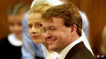 Dutch Prince Johan Friso, second son of Queen Beatrix, and Mabel Wisse Smit during their religious wedding ceremony at the Oude Kerk, or Old Church, in Delft, the Netherlands, Saturday April 24, 2004. Johan Friso will lose his claim to the throne after his marriage, which wasn't sanctioned by the Dutch government, but will retain the title Prince of Orange-Nassau. Wisse Smit won't become a noble. (AP Photo/Dusan Vranic)