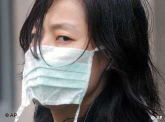 A girl wearing a mask visits the Ditan Hospital in Beijing Sunday, April 25, 2004. With a major national holiday days away, the Chinese government on Sunday exhorted people in a southern province where SARS has resurfaced to take immediate action to prevent the virus from spreading anew. (AP Photo)