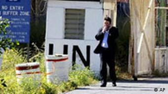A man crosses the U.N.-controlled buffer zone towards Turkish Cypriot part of Nicosia at Ledra Palace on Monday, April 26, 2004, two days after Turkish Cypriots endorsed a U.N. reunification plan by 64.91 percent as Greek Cypriots who rejected it by 75.8 percent. (AP Photo/Burhan Ozbilici)