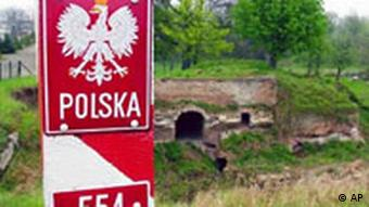 A Polish border post painted in the red and white Polish colors at the German border