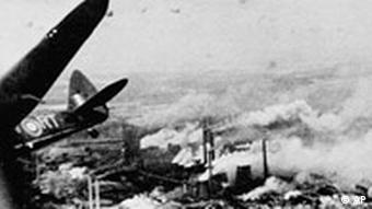 This photo was taken during the height of an R.A.F. attack on the Knapsack power station in the great German industrial city of Cologne, on August 18, 1941. The plane at left has just dropped its bomb salvo from a low level and is heading for home. Anti-aircraft bursts fill the air as the planes press home their attack. The R.A.F. claim to have exacted vast damage. (AP Photo)