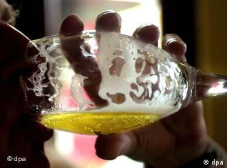 A man empties a beer glass