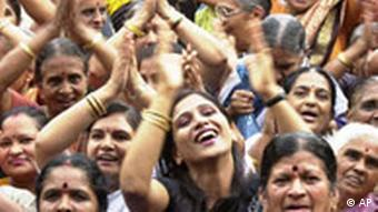 Members of 'International Laughing Club' gesture and laugh as they participate in a function to celebrate World Laughers Day in Bangalore, India