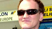 American director Quentin Tarantino, president of the Cannes Film Festival jury, smiles upon his arrival at Nice airport, southern France, Monday May 10, 2004. The festival starts on Wednesday. (AP Photo/Patrick Gardin)