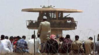 Iraqis outside of Abu Ghraib Prison